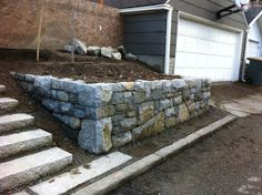 Garden Wall & Steps - There appears to be loose dirt between the wall and steps for planting, which would be pretty.