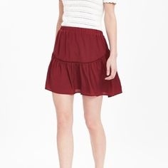 Banana Republic Embroidered Trim Mini Skirt Bought in two sizes and decided to keep the other. This is a size small but fits like a size medium. 100% polyester. This is a super fun, flirty skirt. The waist is elastic so it's very comfy! The color is called Rich Red. Banana Republic Skirts Mini