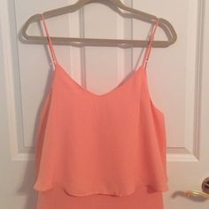 NWT coral tank dress So cute and perfect for summer! Lightweight. Flowy on the front part. Size L = 10-12 in this dress :) adjustable straps as well. Bought from an online boutique! Dresses