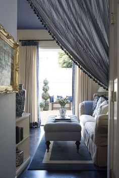 Room by Lee Ann Thornton. Love Portieres in doorways to cozy them up. via Not So Basic Blues - Design Chic