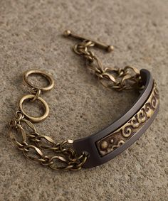 Look at this Antique Goldtone & Black Stamp Bracelet on #zulily today!