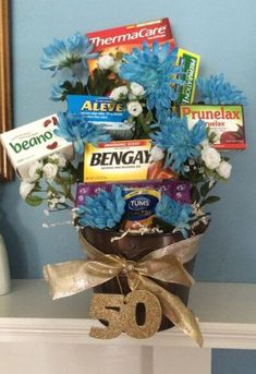 age remedies tucked into a flower arrangement is a comforting idea for a 50 birthday. See more birthday gag gifts and party ideas at www.one-stop-party-Old age remedies tucked into a flower arrangement is a comforting idea for a 50 birthday. 50th Birthday Gag Gifts, 50th Birthday Party Ideas For Men, 70th Birthday Parties, 50th Party, Birthday Fun, 75th Birthday, Women Birthday, Birthday Sayings, Surprise Birthday