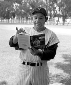 Yogi Berra reading from his 1961 autobiography at Yankee spring training camp.