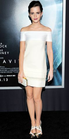 10/02/13: At the Gravity premiere, Emma Watson hit all the right notes in a white off-the-shoulder J. Mendel dress with a subtle tiered silver-accented hem. She complemented her look with two-tone metallic cut-out pumps and a shimmery white clutch. #lookoftheday