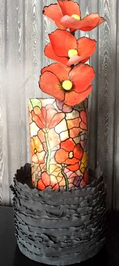 I love the painted stained glass & the poppies but what's with the bottom tier? Is it a nest? Stained Glass And Poppies Cake