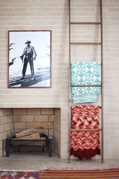 Blankets on display using a wooden ladder to make house feel like home