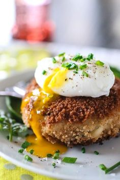Cheesy risotto cakes with poached egg via The Curvy Carrot