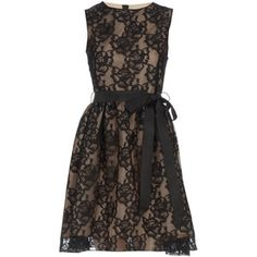Lace is very popular right now. Paired with the nude color underneath this is just lovely.