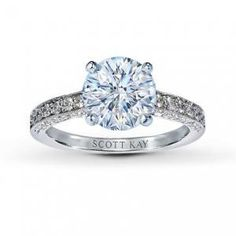 Round Brilliant Diamond Engagement Ring in Pave Setting