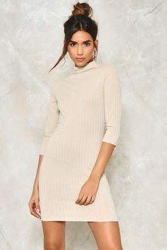 Call me. The Hot Line Dress comes in a ribbed knit and features a mock neck and mini, bodycon silhouette. Team it with sneakers or strappy heels.