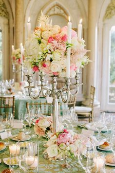 You could use wedding candles in your centerpiece arrangement, decorate tables and chairs. Candelabra Centerpiece, White Centerpiece, Wedding Reception Centerpieces, Floral Centerpieces, Floral Arrangements, Wedding Decorations, Silver Candelabra, Candelabra Flowers, Shower Centerpieces