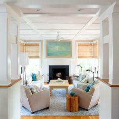 bungalow living room with fireplace and columned room dividers
