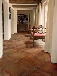 Saltillo tiles instead of wood?  I could do this pattern in stained concrete, DIY project and save $10-15K.
