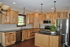 Hickory Kitchen cabinets.   Lancaster House - C&M Properties and Construction. www.candmhomebuilders.com Eau Claire, Wisconsin