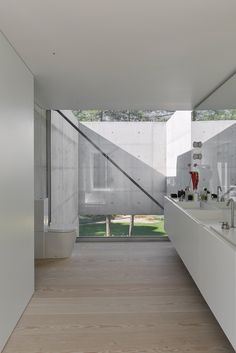 A Pool With a Glass Bottom Hovers Over Another at a House in the Portuguese Riviera - Dwell