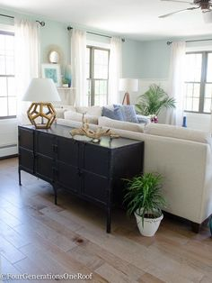 Love the idea of mixing wood + metal decor accents. The wood octagon lamp from HomeGoods (sponsored) helps soften the harsh metal lines of the console. Using a large console is also a great as a sofa table for large sectionals. Coastal Transitional Living Room