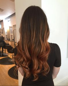 Warm up with this copper balayage look. Hair by SALON by milk + honey stylist, Jen K. #cooperhair #balayage #brunette #ombre #curls #haircolor