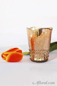 Beautiful Array glass votive cup in rose gold. Use this lovely rose gold glass cup for wedding lighting or creating small floral arrangements to accent your glam wedding decorations for a stylish look!
