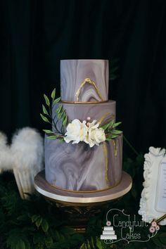 Marble and gold leaf wedding cake (Cupid and Psyche) by Kathryn - http://cakesdecor.com/cakes/257515-marble-and-gold-leaf-wedding-cake-cupid-and-psyche