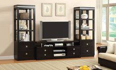 """Features:  -Frame materials: Wood and veneers.  -Finish: Black.  -Square drawer pulls.  -4 Drawers.  -Chrome shelf supports.  -Holds up to 66"""" TV.  TV Size Accommodated: -66"""".  Product Type: -Entertai"""