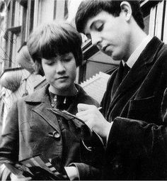 Paul McCartney is signing autograph on 10 February, 1963.