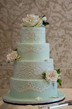 love the piping. i would switch it to blue piping and a white cake. flowers are beautiful too #laceweddingcakes