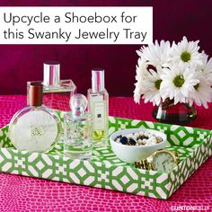Cover a shoebox lid (!) with fabric to create this chic jewelry/perfume tray