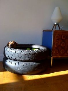 Tire dog bed...although my dogs would probably just try to eat it...its a bed that they could actually fit in. I'm going to have to do this...but semi-truck tires.