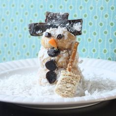 Transform peanut butter snack balls into snowmen for a fun snack that will give your kids the energy they need to play all day in the snow.