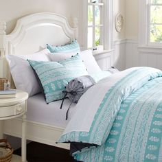 I need a cover for my comforter. Greys, lights pinks, and light blues are the colors of choice.