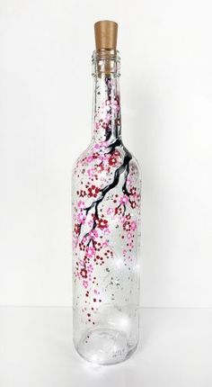 Check out Cherry Blossom Wine Bottle with Fairy Lights at Beer Baron - Paint Nite Hey! Check out Cherry Blossom Wine Bottle with Fairy Lights at Beer Baron - Paint Nite Painted Glass Bottles, Glass Bottle Crafts, Wine Bottle Art, Lighted Wine Bottles, Diy Bottle, Painted Wine Glasses, Glass Lights, Wine Bottle With Lights, Wine Bottle Lighting