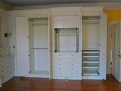 Think we're settling on built-in drawers and cabinet for the tv in the middle, and two separate closets on each side.