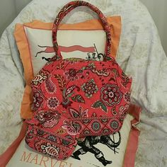 "Vera Bradley Coral Paisley Tote & Cosmetic Bag This pretty coral paisley medium size tote is perfect for carrying all your essentials w/ out being too big. It measures 15"" across, 10"" high & bottom is 7"" wide. Handle drop is 10"". The medium size cosmetic bag will keep your makeup or other items secure inside the bag. Full zip top w/ pretty Ikat pattern inside & zip pocket & 3 slip pockets. Used 5 or 6 times - excellent condition w/ no stains or tears! Vera Bradley Bags Totes"