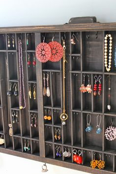 Hang an old drawer on the wall with hooks for your jewelry!