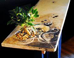 Living table integrates a bonsai tree