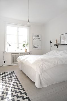 Bedroom - all white - white floor - pattern - wood - rug - window - art