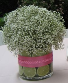 Inexpensive Pretty Centerpiece - Baby's breath in a vase with limes and a pretty ribbon.