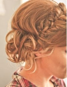 braided and curled messy bun.