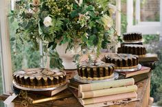 Loving these gear cakes. Vintage frames, gears, and books: A spectacular British steampunk wedding | Offbeat Bride