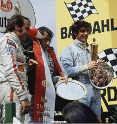 Clay Regazzoni, Jackie Stewart and Francois Cevert on the podium at the German…