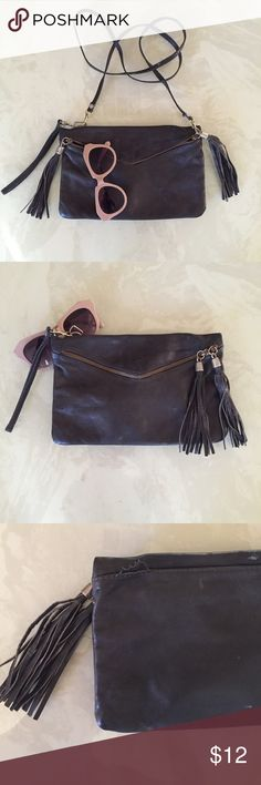 """Vegan leather purse Dark gray vegan leather purse with fringe tassels and gold detailing. It has one interior zipper. Great to hold small items. Straps are detachable (and so is wristlet strap) to make the purse a clutch! Versatile for evenings and daytime excursions ; ) the medal clip for the strap to connect to fell off (pictured in 3rd photo), but I connected it to the other side so it can be sewed back on if buyer desired to.  Height-6.5"""" Length-10.5"""" Width- about 1/2"""" Urban Outfitters…"""