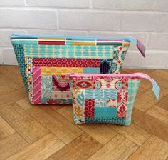 like the extended zippers, also the piecing and horizontal quilting... Such cute little bags. - - - Pink Stitches: Zippy pouches