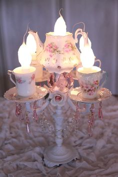 A great idea for a centerpiece.  You could scavenge for old candlabera pieces and china...very pretty indeed!