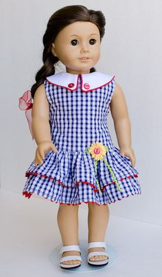 Ruffled red, white, and blue gingham collared dress with flower accent by AnnasGirls. Made with the 1930's Ruffled Play Dress pattern. Find it at http://www.pixiefaire.com/products/1930s-ruffled-play-dress-18-doll-clothes. #pixiefaire #1930sruffledplaydress