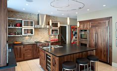 Perfect contemporary design kitchen with the stainless steel furniture and wooden cabinets. #kitchen #cabinet