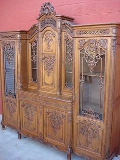 This is a stunning original antique Louis XV buffet that is hand carved out of solid oak and is from Liege. This gorgeous cabinet is 95 tall, 92 3/4: $20,000