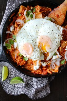 Chilaquiles are an easy Mexican dish of leftover tortillas simmered in a quick tomato sauce. It's often served for breakfast or brunch, and I love it with a fried egg.