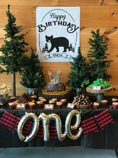 You guys. This Lumberjack Plaid first birthday party couldn't have been any cuter. All of the balloons, tableware, decor, and signage was from yours