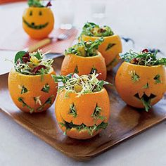 Halloween party food ideas from www.babysavers.com! Individual salads in orange peel jack-o-lanterns!! BRILLIANT!!
