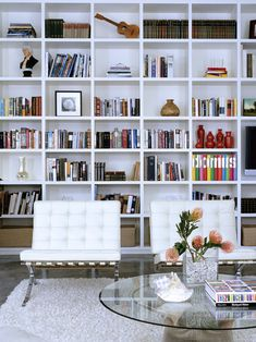Floor to ceiling shelves love how sharp this room looks!
